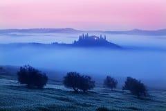 Tuscany landscape at sunrise. Typical for the region tuscan farm house, hills, vineyard. Italy Fresh Green tuscany landscape royalty free stock image