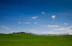 Tuscany landscape with typical farm house Stock Image