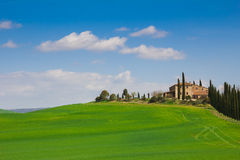 Tuscany landscape with typical farm house Royalty Free Stock Photo