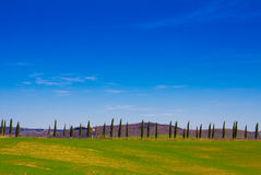 Tuscany landscape with typical farm house Royalty Free Stock Images