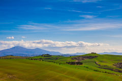 Tuscany landscape with typical farm house on a hill in Val d'Orcia Stock Photo