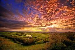Tuscany majestätisk solnedgång Arkivfoton