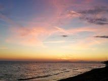 Italy, Tuscany Maremma, Grosseto, Castiglione della Pescaia, sunset photos on the sea, in the background the island of Elba. Tuscany Maremma, Grosseto royalty free stock photo