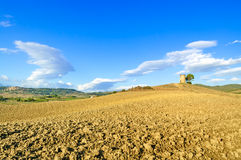 Tuscany, Maremma landscape. Rural tower, plowed field, village on background. Stock Image