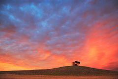 Tuscany, Maremma red sunset landscape. Rural tower and tree on h Stock Photo