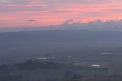 Tuscany in mist before sunrise Stock Photos