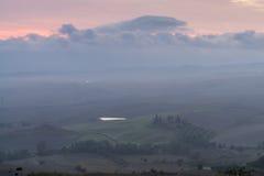 Tuscany in mist before sunrise Stock Photo