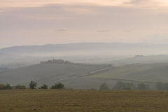 Tuscany in mist before sunrise Stock Image