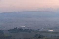 Tuscany in mist before sunrise Stock Photos