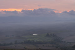 Tuscany in mist before sunrise Royalty Free Stock Photo
