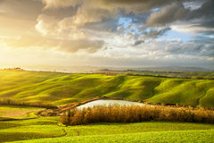 Tuscany misty panorama at sunset, rolling hills, lake, fields, m royalty free stock photography