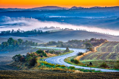 Tuscany på soluppgång Arkivfoto
