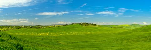 Tuscany panoramic view from drone in the spring time. With green filds stock image