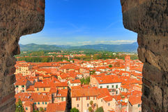 Tuscany - Red Roofs of Lucca. View of the red roofs of Lucca and distant Tuscan countryside from the Guinigi tower Stock Photos