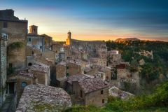 Tuscany, Sorano medieval village panorama sunset. Italy. Tuscany, Sorano medieval village on tuff rocky hill. Panorama sunset. Italy, Europe Royalty Free Stock Photo