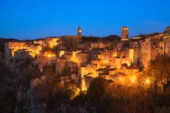 Tuscany, Sorano medieval village blue hour sunset panorama. Ital. Tuscany, Sorano medieval village on tuff rocky hill. Blue hour sunset panorama. Italy, Europe Royalty Free Stock Photography