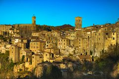 Tuscany, Sorano medieval village blue hour sunset panorama. Ital. Tuscany, Sorano medieval village on tuff rocky hill. Sunset panorama. Italy, Europe Stock Photos