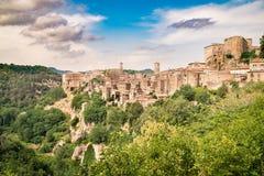 Tuscany, Sorano medieval village on tuff rocky hill. Tuscany, Sorano medieval village on tuff rocky hill, Italy stock photos