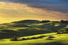 Tuscany spring, rolling hills on sunset. Rural landscape. Green Royalty Free Stock Images