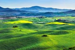 Tuscany spring, rolling hills on sunset. Volterra rural landscap Stock Images