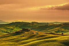 Tuscany spring, rolling hills on sunset. Volterra rural landscap Royalty Free Stock Photography