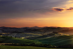 Tuscany spring, rolling hills on sunset. Volterra rural landscap Stock Images