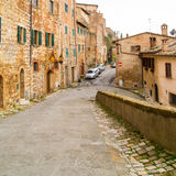 Tuscany, street view of medival town Montepulciano. Montepulciano, Italy - November, 15, 2014: Tuscany, street view of medival town Montepulciano at Tuscany Royalty Free Stock Photo