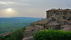 Tuscany sunset. Ancient center of village Volterra overlooking the rural landscape of Tuscany, Italy at sunset stock footage