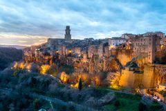 Tuscany Sunset on Pitigliano, Italy. Pitigliano sunset near Tuscany, Italy, cloudscape and landscape featuring the famous tower royalty free stock photo
