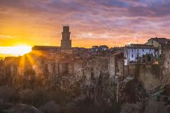 Tuscany Sunset on Pitigliano, Italy. Pitigliano sunset near Tuscany, Italy, cloudscape and landscape featuring the famous tower stock photography