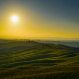 Tuscany, sunset rural landscape. Rolling hills and farmland. Stock Images