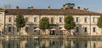 Tuscany town, Italy. An old riverside home in Italy Stock Image