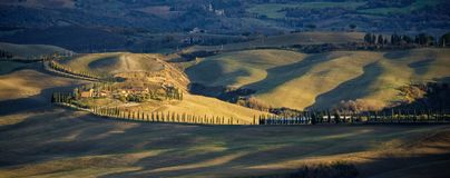 Tuscany. Tuscan landscape, rolling hills in the light of the sunset. Italy stock photo