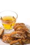 Tuscany typical cookies with almonds with a glass of wine Royalty Free Stock Photography