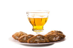 Tuscany typical cookies with almonds with a glass of wine Stock Photo