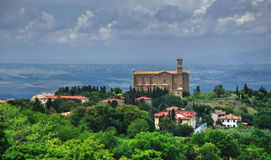 Tuscany view on stone church in Volterra, Italy royalty free stock photography