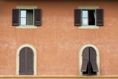 Tuscany windows with brown shutters. Details of typical Tuscany house Royalty Free Stock Photography