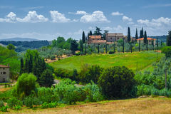 Tuscany  Wine Farm House. With blue sky and clouds Stock Photos