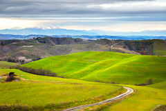 Tuscany, winter rural landscape. Countryside farm, white road an Royalty Free Stock Image