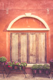 Tuscany wooden window on orange old wall Royalty Free Stock Photography