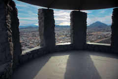 Tuscon View. At a peak, in Tuscon, rests a stone monument that beautifully frames the city Royalty Free Stock Photography