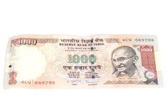 Tusen rupieanmärkning (indisk valuta) som isoleras på vita lodisar Royaltyfri Foto