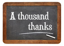 Tusen tack på svart tavla arkivfoto