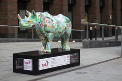Tusk RhinoTrail - The Poppy Rhino situated near the Millennium Bridge and St Paul`s Cathedral in London stock photography