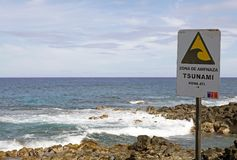 Tsunami warning sign, Eastern Island, Chile. Tusnami warning sign on the coast at the eastern Island, Chile Royalty Free Stock Images
