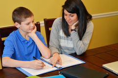 Tutor. Helping a young student with his studies