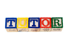Tutor. The word tutor, spelled using wooden letter blocks, isolated against a white background Stock Photo