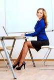 Tutor at a classroom Stock Photo