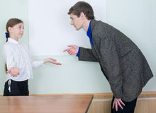 Tutor explains something to the girl Stock Image