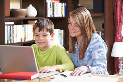 Tutor Helping Boy Studying At Home. Tutor Helps Boy Studying At Home Stock Images